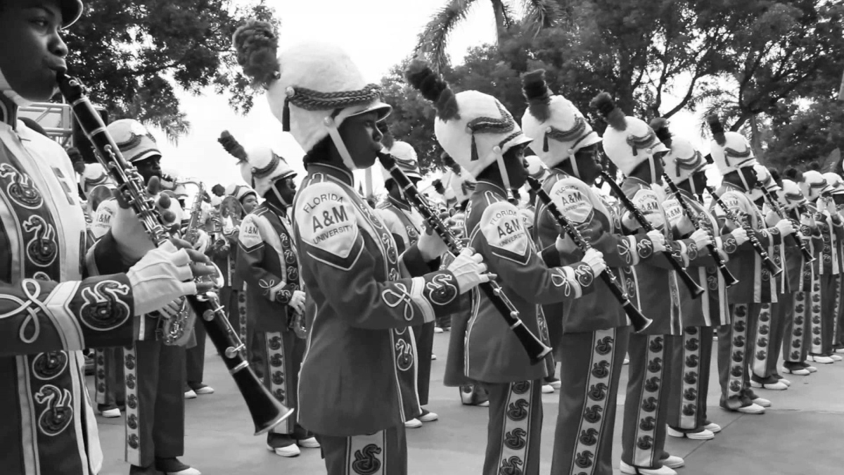 "EXCERPTS FROM ""THE MAN BEHIND THE BATON"" BY DR. WILLIAM P. FOSTER: Excerpt Nine - The FAMU Band Motto"